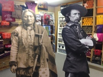 Cardboard cutouts of Sitting Bull and General Custer in the Custer museum gift shop.