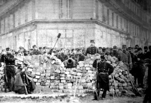 Regular troops man a barricade against the Paris Commune.